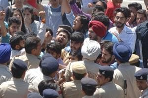 ABVP activists during their protest in front of V­C's office at Panjab University in Chandigarh on Monday.