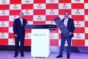 Airtel's DTH divison CEO Sunil Taldar (right) launches the new Internet TV set top box in an event in New Delhi on Wednesday.