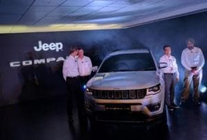 FCA India president and MD Kevin Flynn with other company officials at the unveil of the Jeep Compass at its Ranjangaon plant near Pune.
