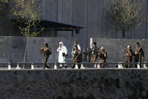 Afghan security forces arrive to inspect the site of suicide bomb attack in Kabul, Afghanistan April 12, 2017.