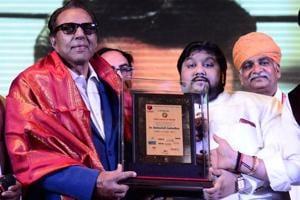 Dharmendra being honoured at the Dr Babasaheb Ambedkar Nobel Award in Mumbai