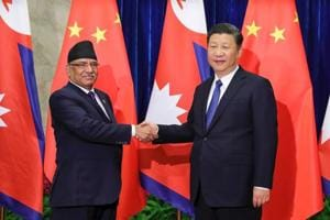 Chinese President Xi Jinping (right) shakes hands with Nepalese Prime Minister Pushpa Kamal Dahal  at the Great Hall of the People in Beijing on March 27.