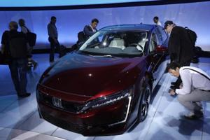 Journalists look over the fuel cell version of the Honda Clarity being displayed at the 2017 New York International Auto Show in New York City.