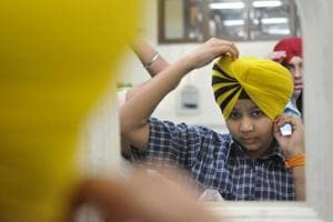 A boy participates in a turban-tying competition held at the Sarabha Nagar gurdwara on the occasion of Baisakhi in Ludhiana on Thursday, April 13.