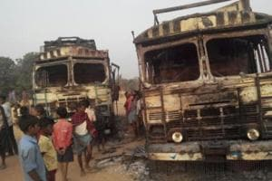 Two of the five trucks set on fire by suspected Maoists in Bihar's Lakhisarai district.