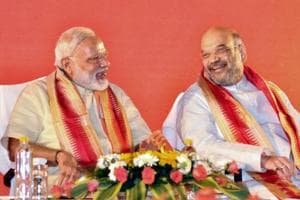 Prime Minister Narendra Modi with party president Amit Shah at BJP