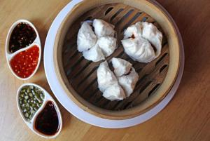 The BBQ chicken baos were light and flavourful, the steamed bread encasing sticky spicy nubs of meat.