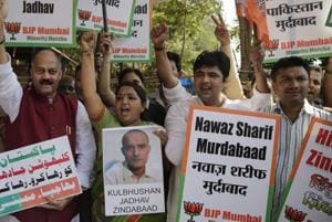 People shout slogans during a protest against the conviction of Kulbhushan Jadhav, in Mumbai.