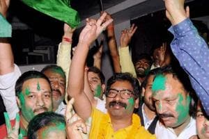 Jharkhand Mukti Morcha leader and former CM Hemant Soren celebrates with party workers after party's victory in Littipara bypoll, in Ranchi.