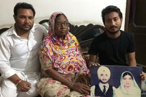 Amrik Singh (left), his mother Angrej Kaur and son Raman Singh hold up a photograph of Surjit Singh, who has been languishing in a Pakistani prison since 1971.