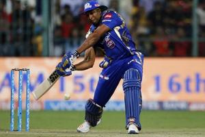 Mumbai Indians Kieron Pollard prepares to play a shot during the Indian Premier League match against Royal Challengers Bangalore in Bangalore on April 14, 2017.