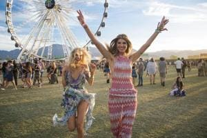 Festival goers Joy Corrigan, left, and Ashley Haas clicked at Coachella Music & Arts Festival.