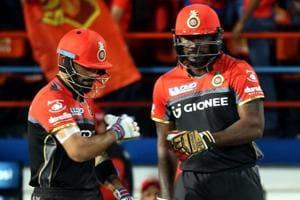 Royal Challengers Bangalore captain Virat Kohli and Chris Gayle during their 2017 Indian Premier League match against Gujarat Lions.