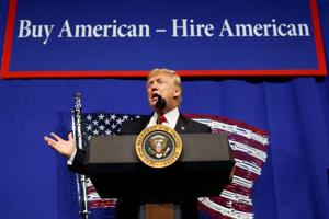 Donald Trump speaks before signing an executive order directing federal agencies to recommend changes to H1-B visa program in Kenosha, Wisconsin.