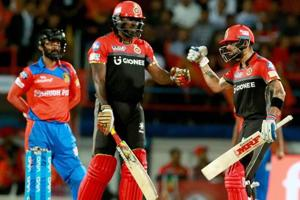 Royal Challengers Bangalore captain Virat Kohli with teammate Chris Gayle during the IPL 2017 T20 match against Gujarat Lions in Rajkot on Tuesday.