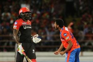 Basil Thampi of the Gujarat Lions (GL)celebrates the wicket of Chris Gayle of Royal Challengers Bangalore (RCB) during their 2017 Indian Premier League (IPL) match at the Saurashtra Cricket Association Stadium in Rajkot on Tuesday.