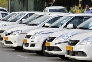 Radio taxies of different Taxi providing companies stands in a long queue outside Delhi Secretariat, as taxi drivers sitting on dharna.