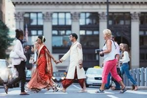 "This is what a wedding portrait looks like in 2016.  A newly married couple en route to the reception venue in downtown Philadelphia. ""We wanted her to lead,"" says the photographer, Shivali Chopra. ""Why should he lead always?"""