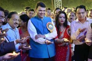 Union science minister Harshavardhan (L) along with CMDevendra Fadnavis and his wife Amruta (2ndR) during the Bhagwan Mahavir Birth-Kalyanak Mahostsav celebration at August Kranti Maidan in Mumbai.