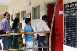 Voters stand in queue to cast their ballot during the 2012 MCD elections in New Delhi.