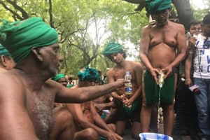 Tamil Nadu farmers preparing to drink urine collected in a bucket at Jantar Mantar on Saturday.