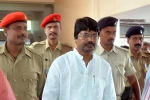 Former minister Yogendra Sao being taken to Rajendra Institute of Medical Sciences, Ranchi,  under judicial custody by police personnel  for medical examination