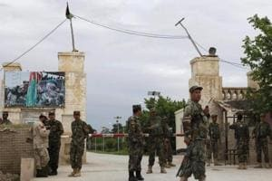 Confusion, chaos after Taliban breach Afghan military base killing 140...