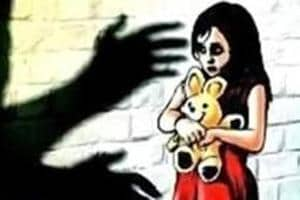 The accused was accused of raping the five-year-old girl, and then burying her neck-deep in sand.