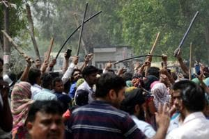 When police cane-charged the protesters, they started pelting bricks and stones on police and MC officials.