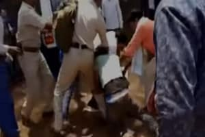 Watch: BJP leader's relatives thrash cop after he fined two for riding...