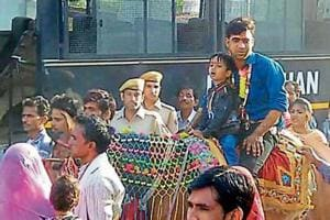 Police officials turn 'baraatis' as Dalit groom rides mare