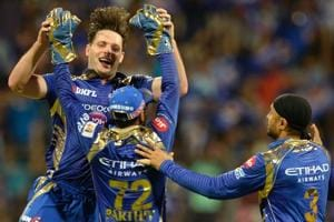 Mumbai Indians pacer Mitchell McClenaghan celebrates with his teammates after taking the wicket of Delhi Daredevils batsman Shreyas Iyer during their 2017 Indian Premier League (IPL) T20 match at the Wankhede Cricket Stadium in Mumbai on April 22.