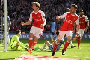 Arsenal want to win FA Cup for Arsene Wenger, says Aaron Ramsey