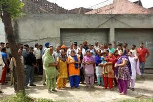 Residents during a protest at Jindowal village near Banga.