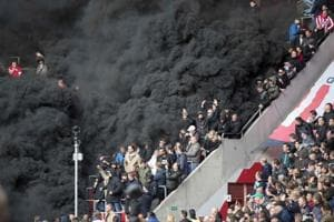 Giant smoke bombs burst in PSV Eindhoven v AFC Ajax Eredivisie...