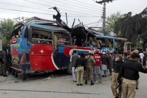 At least 10 in minibus killed by roadside bomb in northwest Pakistan