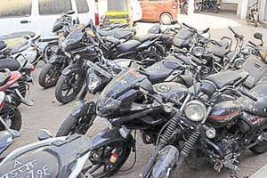 Thane cops seize 16 two-wheelers and 10 phones from 22-year-old and...