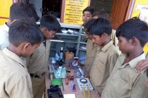 Students of government schools of Miyaganj performing science experiments.
