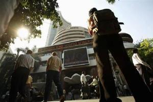 Sensex hits new high of 30,184 intra-day, ends lower as Trump tax plan...