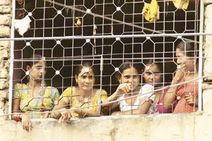 Sex workers at Garstin Bastion road, New Delhi.  They must deal with emotional, health and financial crises all the time