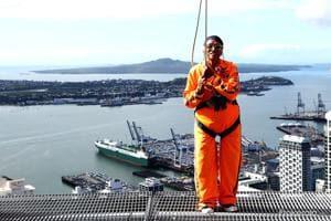 Mann Kaur preparing to skywalk around Auckland's Sky Tower.