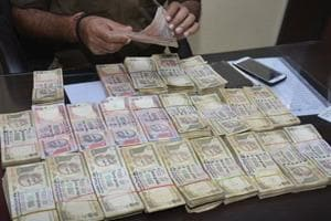 7 held in Bengaluru with demonetised notes of face value Rs 96.9 lakh