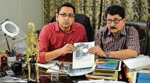 Forensic expert VC Misra (right) with his son Manas Mishra. Misra, 62, is one of India's better known handwriting experts and claims to have cracked about 5,000 cases involving questioned documents, signatures and fingerprints.