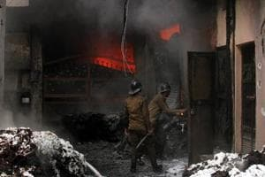 Firefighters trying to douse the flames at DG Kapoor Spinning Mill near Basti Jodhewal Chowk. The textile factory caught fire due to a short circuit on Saturday.