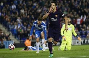 La Liga: Luis Suarez double keeps FC Barcelona level with Real Madrid...