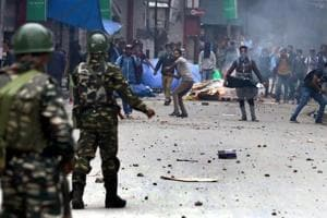 Kashmiri youth clashes with forces in Srinagar.
