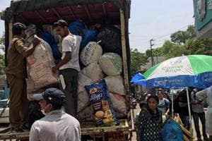 Residents help gather plastic waste to be sent to Pune.