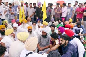 Victim Harpreet Singh's father Yadvinder Singh (centre) with students and other protesters outside Khalsa College in Amritsar on Monday, May 1.