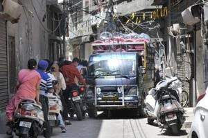 A mini truck carrying goods stuck in a narrow street in Subhash Nagar area in Ludhiana.