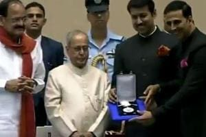 Actor Akshay Kumar receives his National Film Award from President of India Pranab Mukherjee. Standing between Akshay Kumar and Pranab Mukherjee is Rajyavardhan Singh Rathore, minister of state for information & broadcasting.